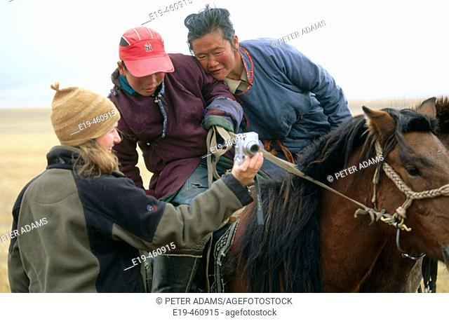 Woman showing nomads digital pictures, Mongolia