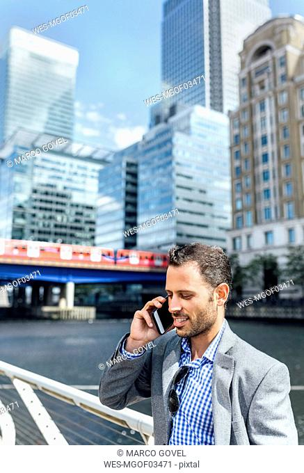 Businessman talking on the phone in the city