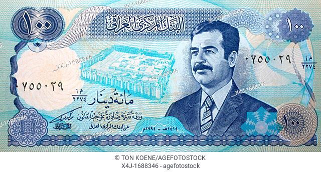 Portrait of Saddam Hussein on a dinnar note