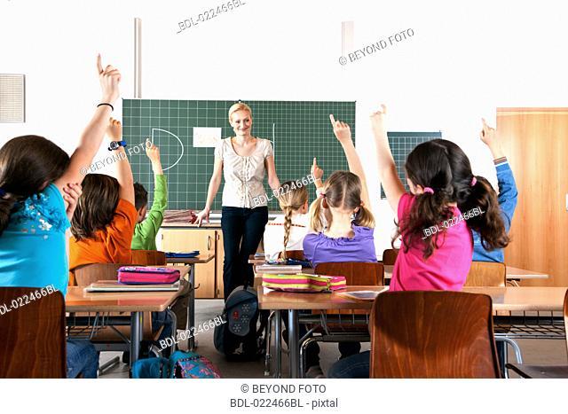 female teacher in front of class