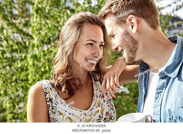 Happy couple in love on balcony