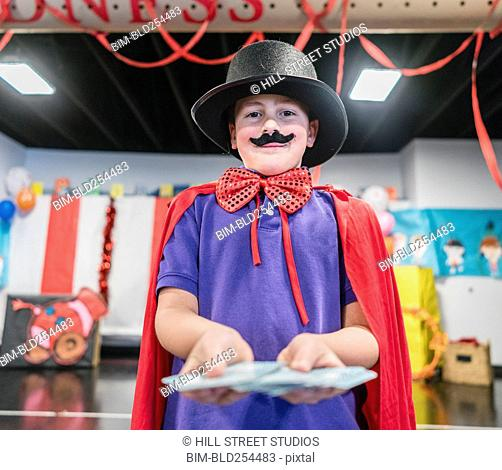Magician boy performing in theater circus