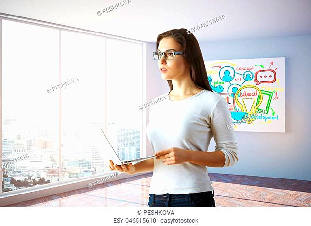Attractive thoughtful young woman holding laptop in interior with panoramic city view and business sketch on poster. Success concept. 3D Rendering