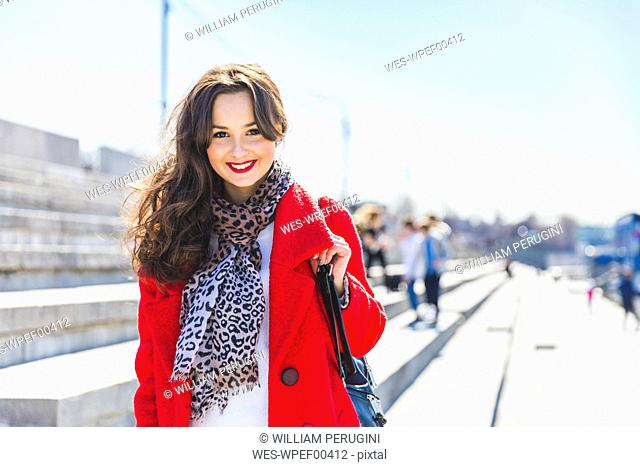 Russia, Moscow, portrait of beautiful young woman in the city