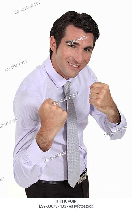 smiling businessman ready for fight