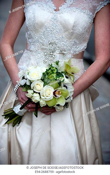 A close up of a bridal bouquet in the hands of a bride.Memphis, Tennessee, USA