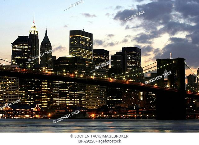 USA, United States of America, New York City: Skyline of south Manhattan, at dusk. View from Brooklyn, Brooklyn Bridge, East River
