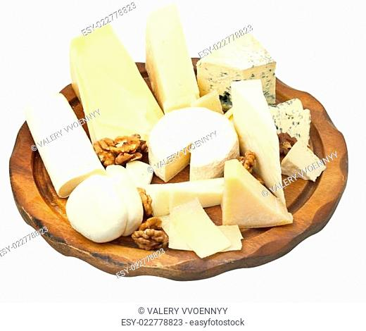 wood plate with various cheeses