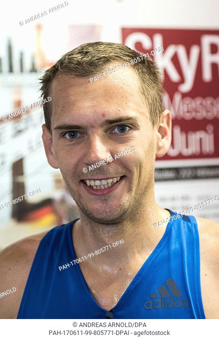 Piotr Lobodzinski from Poland, winner of the race after crossing the finish line in Frankfurt am Main, Germany, 11 June 2017
