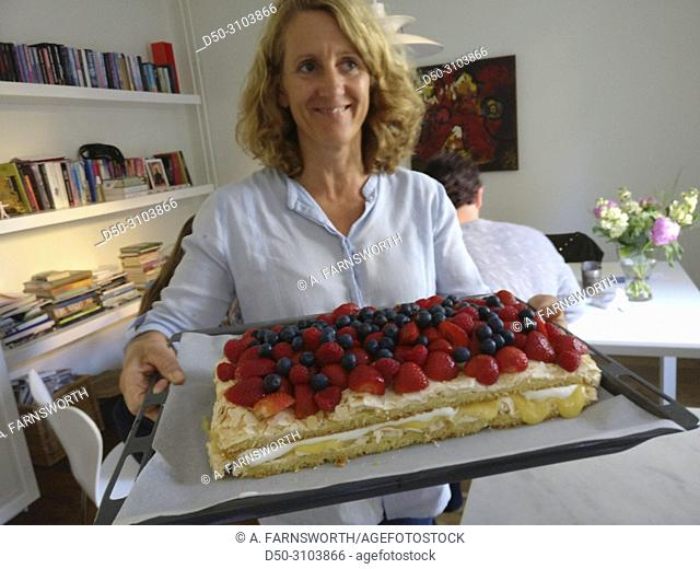 A 52 Year Old Woman Celebrates Her Birthday With Cake Berries Stockholm