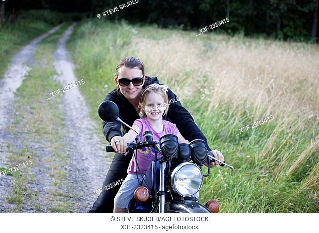 Hip Polish mom giving her daughter a ride on a motorcycle age 34 and 6. Zawady Central Poland