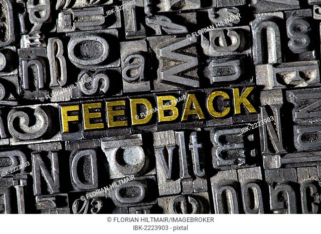 Old lead letters forming the word FEEDBACK