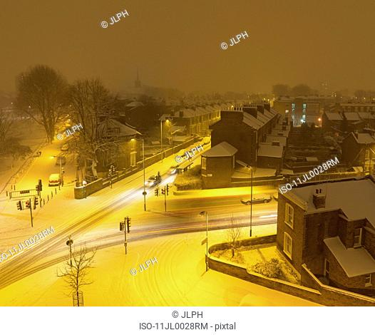 Snow-covered crossroads at night