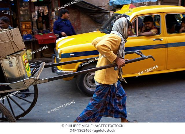 India, West Bengal, Kolkata, Calcutta, rickshaw on the street