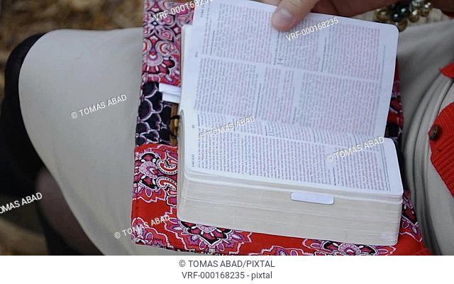 Latino woman reading bible