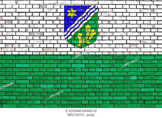 flag of Tartu County painted on brick wall