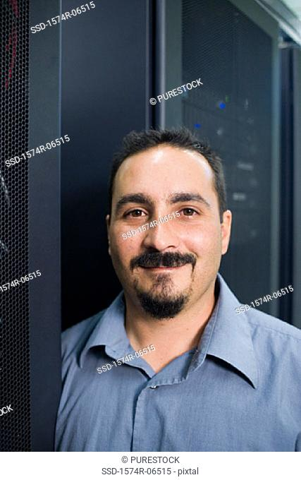 Portrait of a technician in a server room