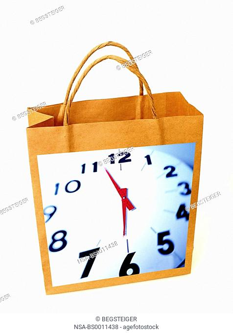 shopping-bag with clock, symbolic for shopping hours