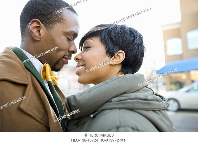 Affectionate couple standing on city street