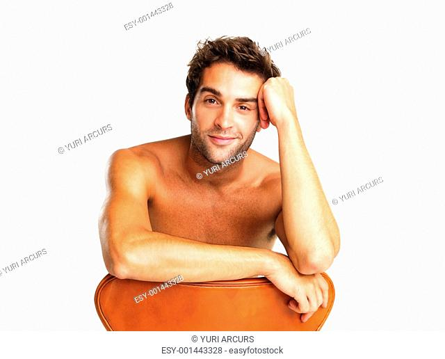 Shirtless man listening in amusement