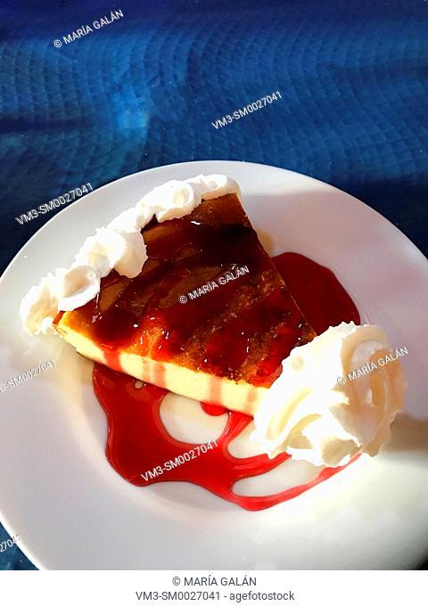 Cheese cake with cream and strawberry jam