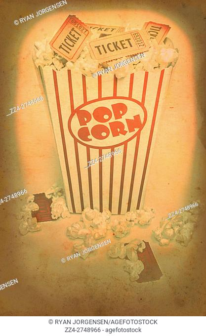 Vintage red and white striped iconic pop corn container holding film tickets in classic show business styles. Vintage cinema pop corn artwork