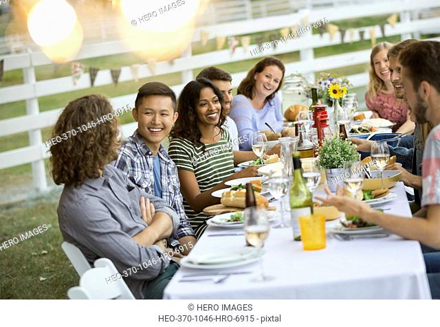 Group of friends having outdoor dinner party