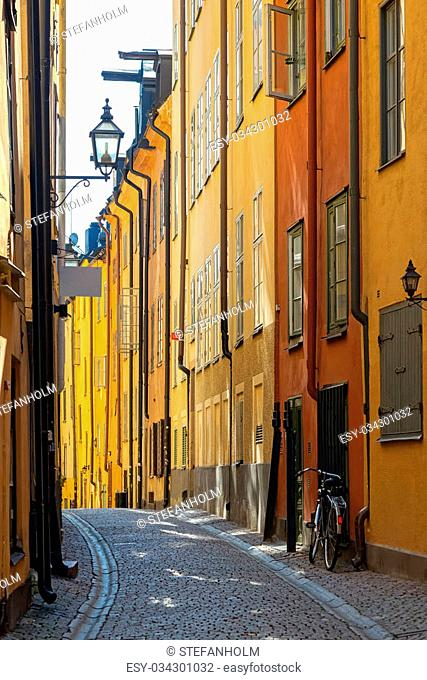 STOCKHOLM, SWEDEN - AUGUST 10, 2015: Cobblestone covered street of Prastgatan in Stockholm old town with a bike parked at the wall