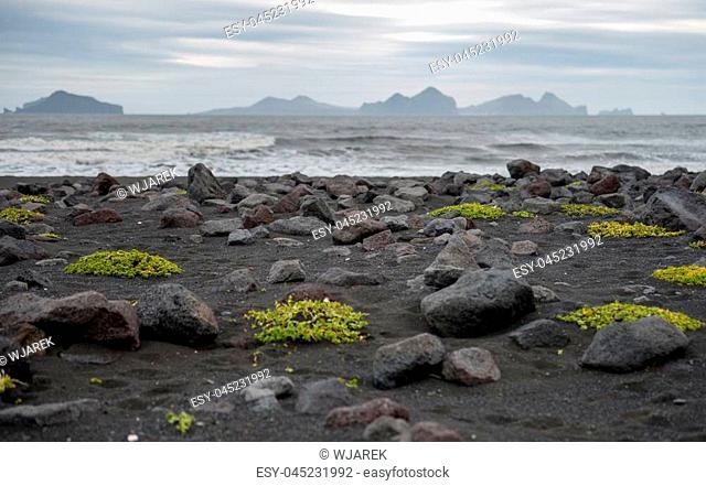 Iceland southern coast with black beach Landeyjarsandur and Vestmannaeyjar islands. The Westman Islands in the background