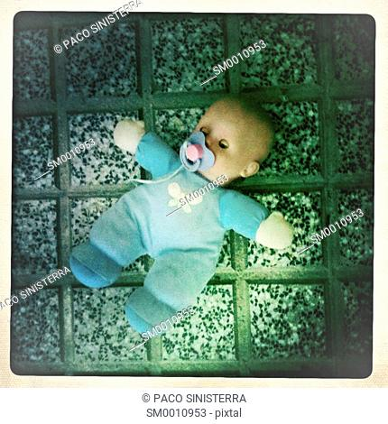 doll baby abandoned in street, Madrid, Spain