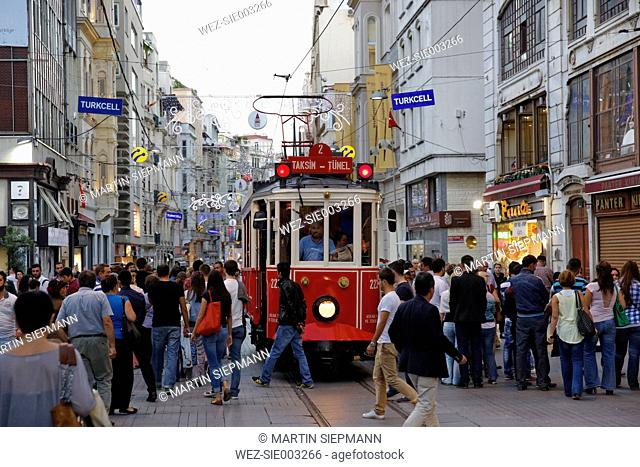 Turkey, Istanbul, People and historical tram on Istiklal Caddesi road