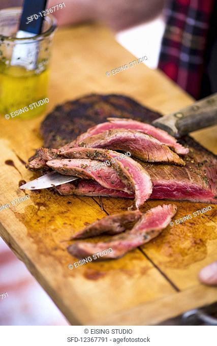 Grilled flat steak, sliced