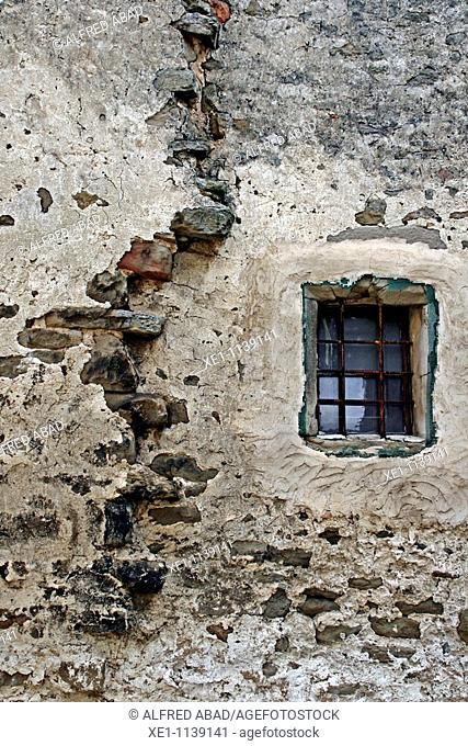 windows on a stone wall, Molsosa, Solsones, Catalonia, Spain