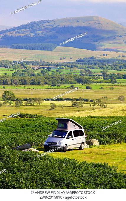 Camper Van parked on moor The Lake District National Park, Cumbria, England, UK
