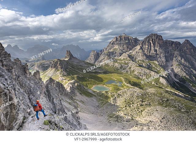 "Sesto / Sexten, province of Bolzano, Dolomites, South Tyrol, Italy. Climber on the via ferrata """"De Luca-Innerkofler"""" to the Mount Paterno"