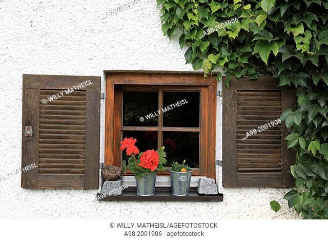 Close Up of a weathered wooden window with wooden shutter at Bavarian Farmhouse, Germany, Europe