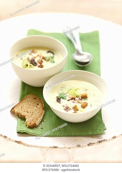 Potato soup with ramsons wild garlic, prunes and bacon
