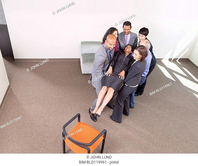 Business people doing team building exercises