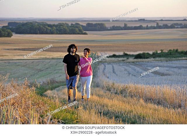 couple of young people walking around Mittainville, Yvelines department, Ile-de-France region, France, Europe