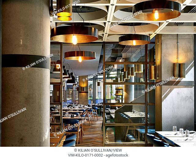 View through restaurant with laid tables. Jamie's Italian, More London, London, United Kingdom. Architect: Stiff + Trevillion Architects, 2015