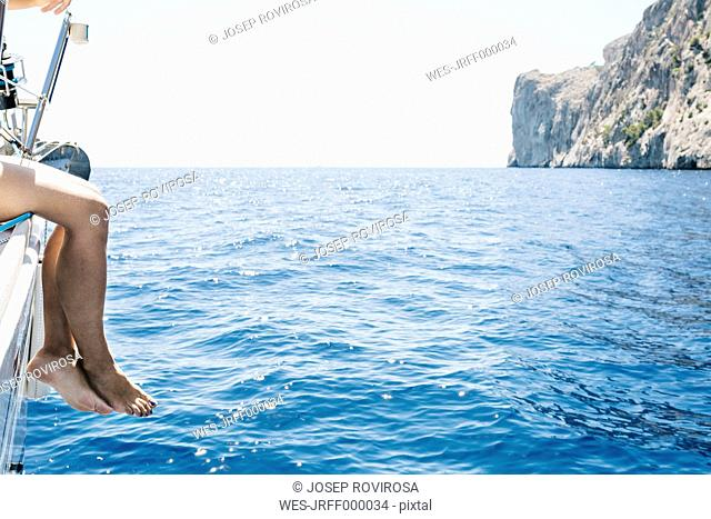 Spain, Mallorca, Woman sitting on sailing boat