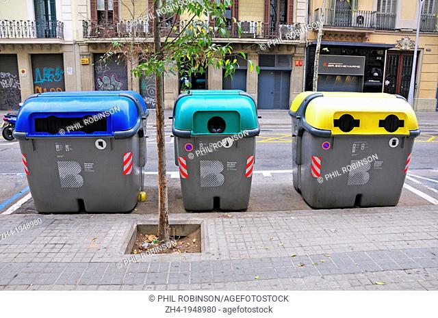 Barcelona, Catalonia, Spain. Recycling bins in the street for paper, glass and tins