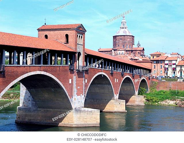 Historical covered bridge over the TICINO River in Pavia City in Italy