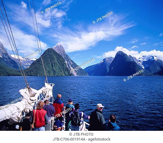 Pleasure boat Milford Sound Fiordland New Zealand Blue sky Clouds Tourist Water surface Ship Deck