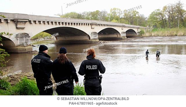 Police divers sweep the area surrounding the Elster river basin for traces inLeipzig, Germany, 27 April 2016. After parts of a female body were found in the...