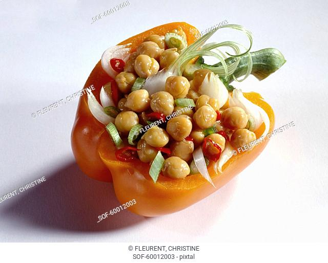 Chickpea salad served in half an orange bell pepper
