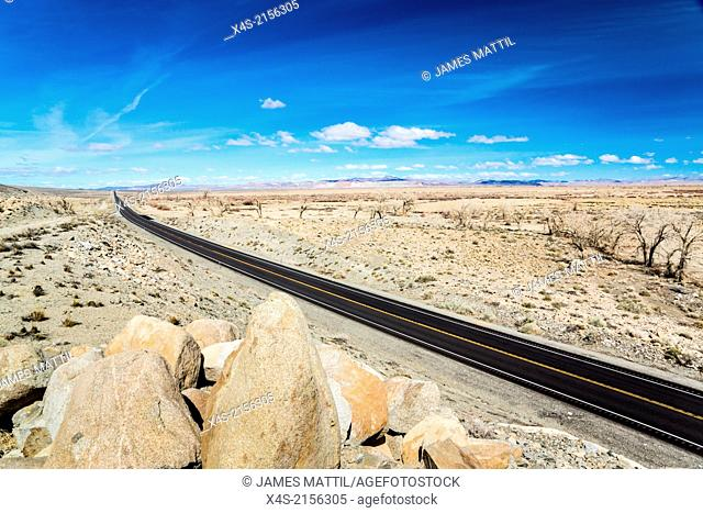 A modern highway races across the ancient landscape in Nevada's Great Basin