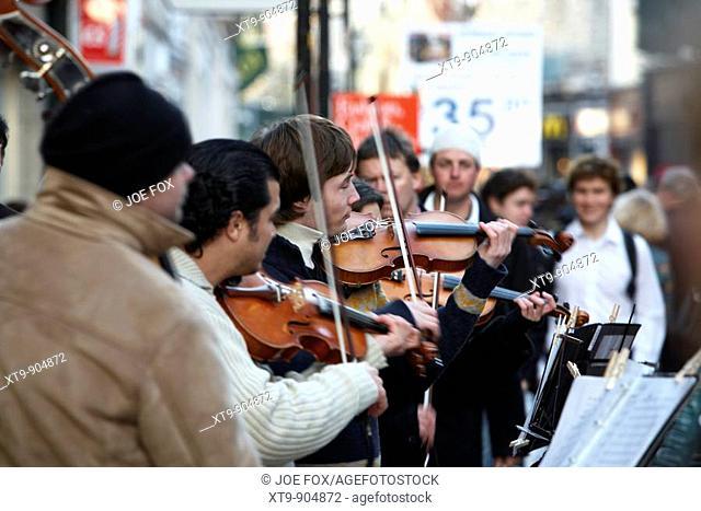 violin playing buskers on grafton street Dublin, Republic of Ireland