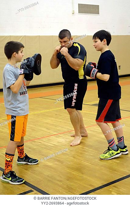 Boxer Giving Lessons to Middle School Students, Wellsville, New York, USA