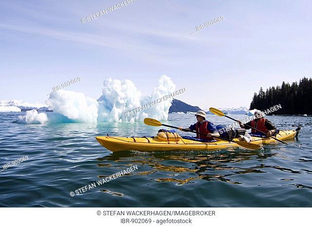 Sea kayak paddling through ice bergs, double, Columbia Bay, Pacific Coast, Chugach National Forest, Prince William Sound, Alaska, USA
